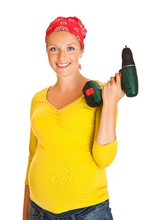 Pregnant woman with powertools isolated on white photo