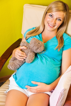 babyroom: Pregnant woman in baby room Stock Photo