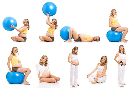 Pregnant woman gymnastic isolated on white 写真素材