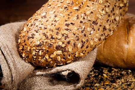 bread basket: Composition of fresh bread on wood