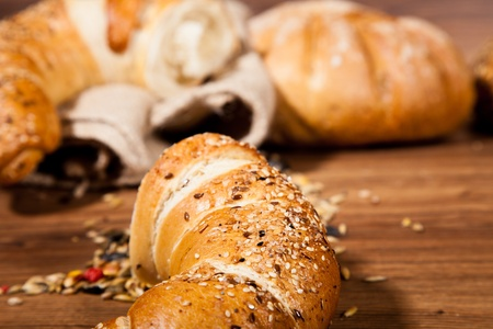 Composition of fresh bread on wood photo