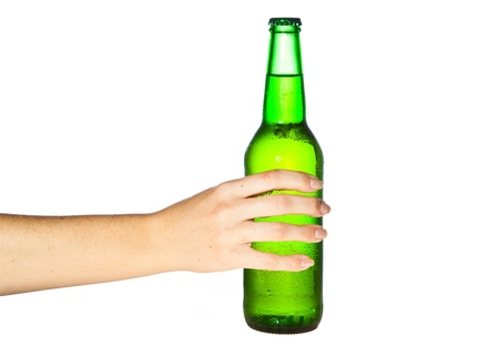 Woman hand holding bottle of beer photo