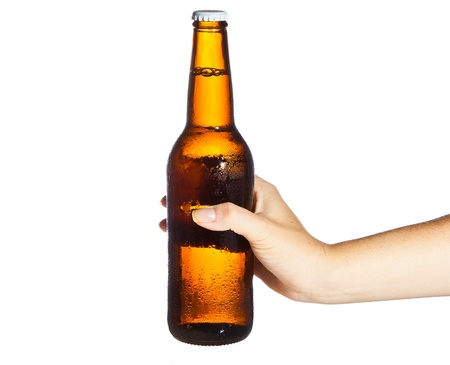 foam hand: Woman hand holding bottle of beer Stock Photo
