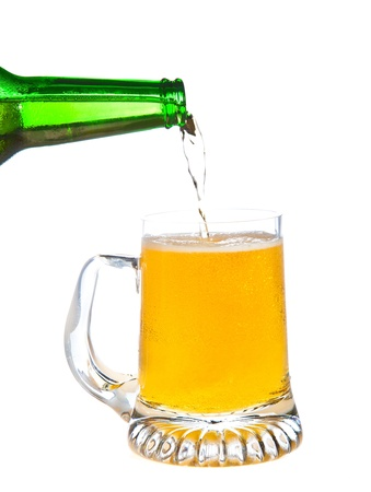 Pouring beer isolated on white photo