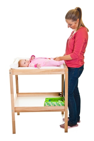 changing diaper: Mother changing little girls diaper on nursery table  Stock Photo