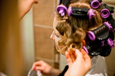 Woman curling hair photo