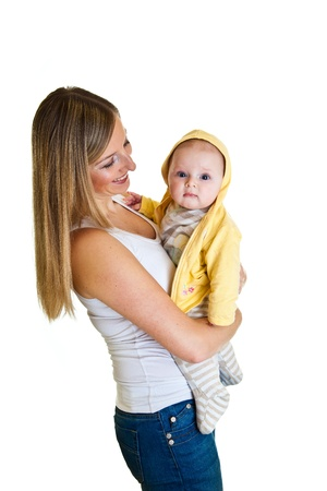 Mother with happy and cute infant baby girl isolated on white photo