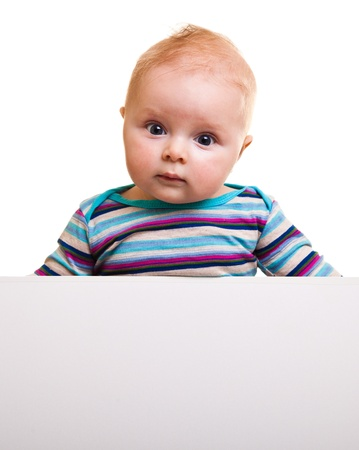 Isolated beaufiful caucasian infant baby behind whiteboard photo