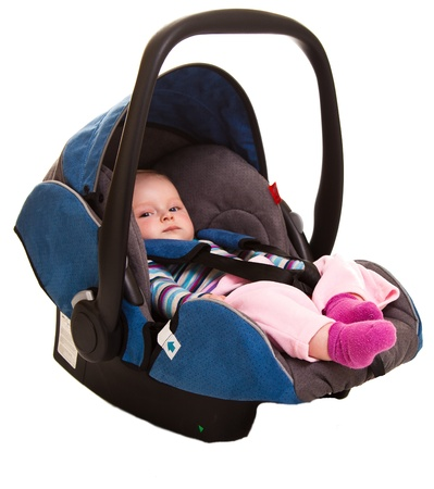 Infant child sitting in car seat photo