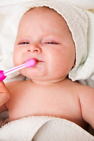 Infant with toothbrush photo