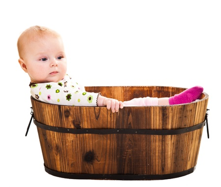 Cute infant girl sitting in wooden bucket Stock Photo - 12438269