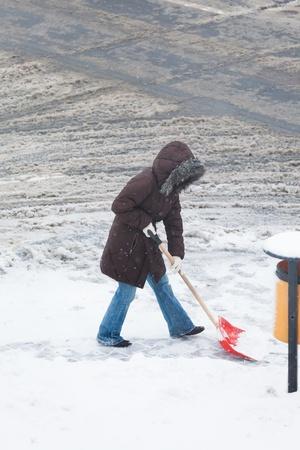 Woman shoveling snow photo