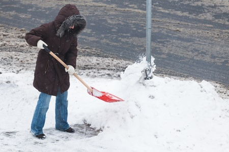 Woman shoveling snow photo