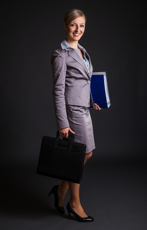 Woman in formal dress on dark gray background Stock Photo - 12946420