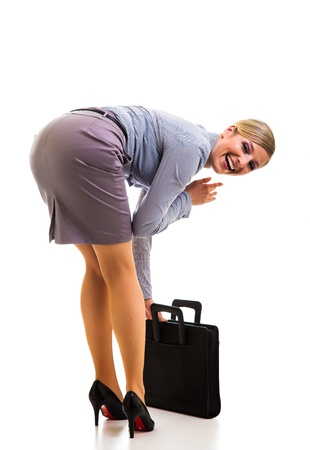 sexy businesswoman: Happy businesswoman with briefcase isolated on white