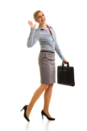 Happy businesswoman with briefcase isolated on white