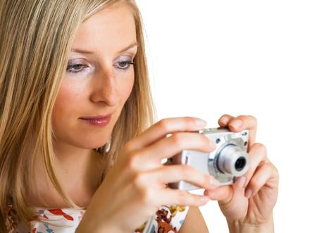 Woman taking photos isolated on white photo