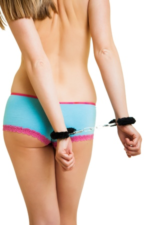 trapped: Girl in panties and handcuffs isolated on white Stock Photo