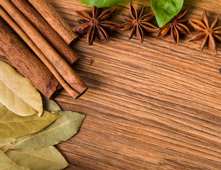 Frame composition of spices on wood, anise,cinnamon,pepper, laurel photo