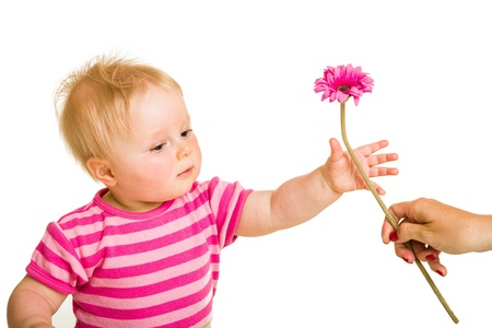 Infant girl giving flower photo