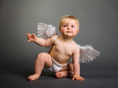 angel hair: Infant baby with angel wings on neutral background
