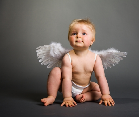 baby diaper: Infant baby with angel wings on neutral background