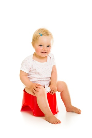 piddle: Toddler girl potty trainting isolated on white Stock Photo
