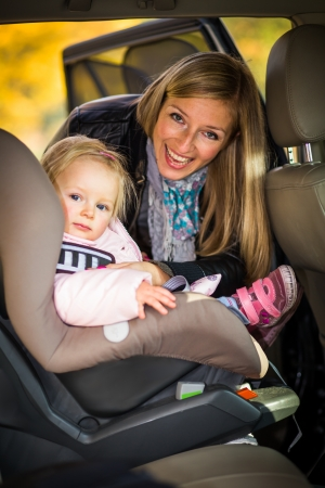 baby on chair: Infant baby girl in car seat Stock Photo