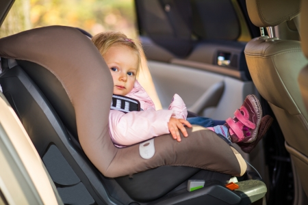car seat: Infant baby girl in car seat Stock Photo