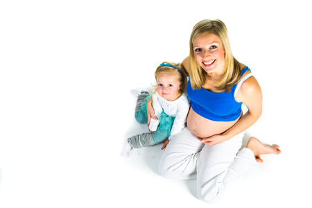 Pregnant woman with 2 zo daughter on white photo