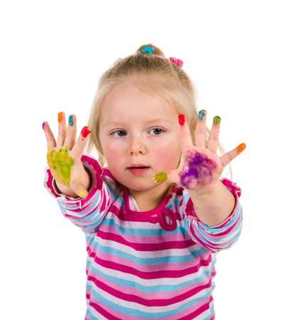 Child painting with fingers isolated on white  photo
