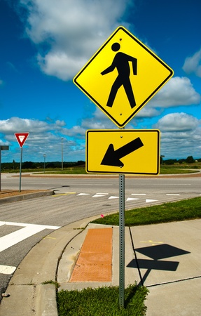 Sign in the street on a blue sky day. Stock Photo - 13292668