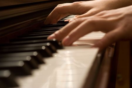 keyboard player: Pianists hand playing the piano Stock Photo