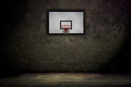 Basketball hoop on empty outdoor court Stock Photo