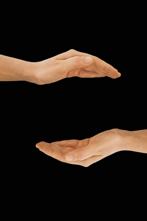 Hands making empty space, isolated on black background