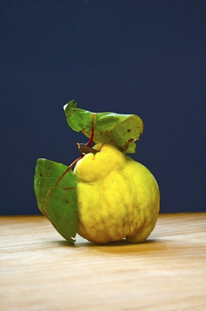 Quince fruits on wooden board