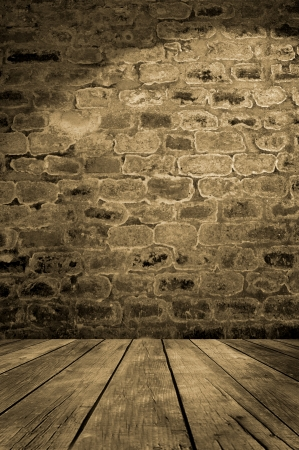 Old brick wall with wooden floor, empty interior
