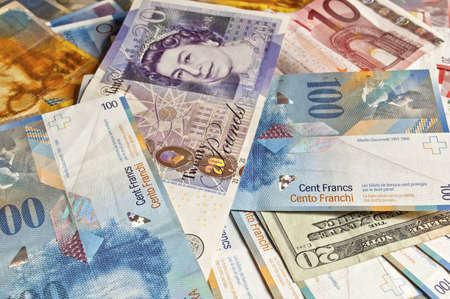 swiss franc note: Banknotes from different countries, business money background