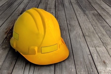 Construction helmet on wooden background photo
