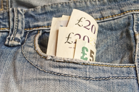 British pounds in the jeans pocket