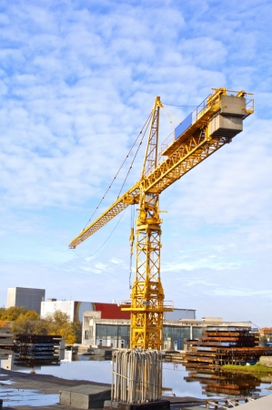 Yellow crane and blue sky on building site Stock Photo