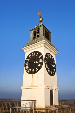 Big Petrovaradin clock tower on the right bank of Danube river in Novi Sad, Serbia