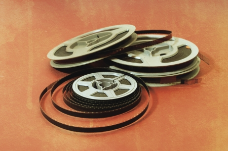 Still life of 8mm cine film reels over a grunge background Stock Photo