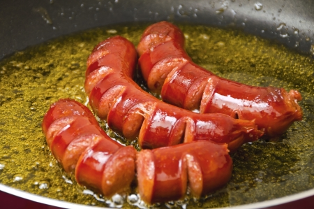 Delicious sausages in frying pan Stock Photo - 17216663