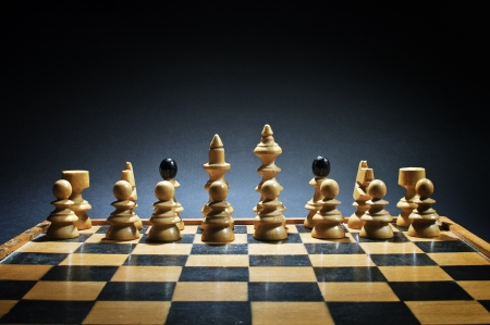 Chess board with chess pieces on dark background Stock Photo - 17216669