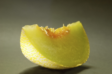 Slice of ripe melon on illuminated background with shadow Stock Photo - 17259510