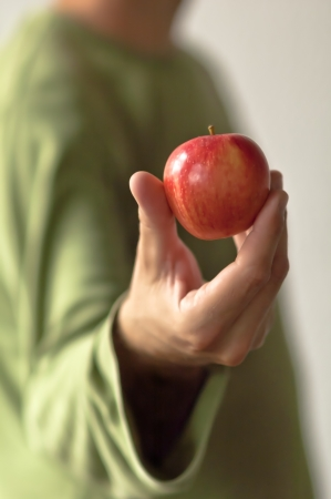 Man with a red apple in his hand  Apple in focus  Stock Photo - 17259508