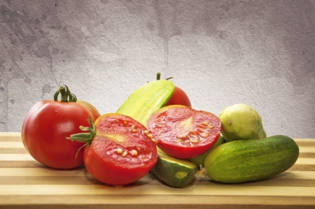 Tomatoes and cucumbers on a wooden plate Stock Photo - 17380788