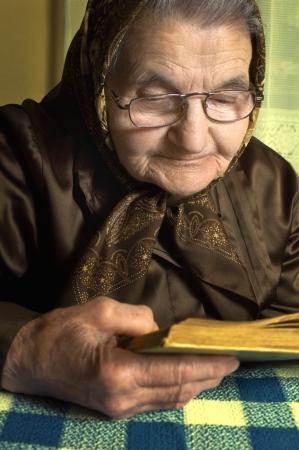 Senior woman reading book at home Stock Photo