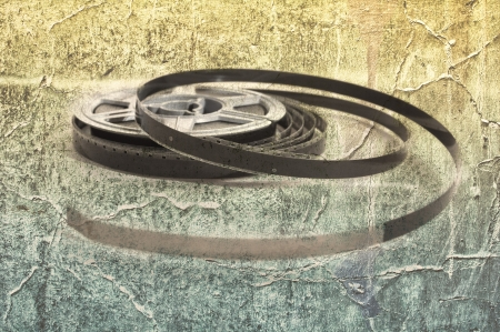 Still life of 8mm cine film reels over a grunge background photo